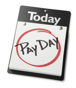 Calendar with the words 'pay day' circled in red for payday loans payment